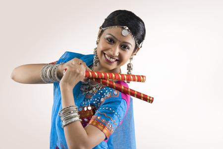 cheerfulness: Gujarati woman performing dandiya