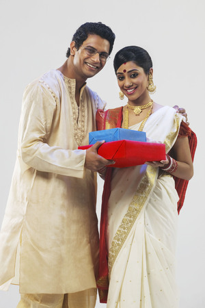 dhoti: Portrait of a Bengali couple with gifts