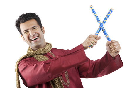 Gujarati man with dandiya sticks