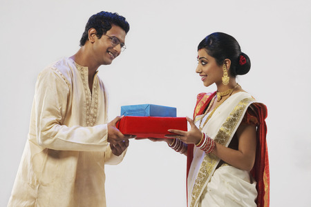 Bengali couple holding gifts