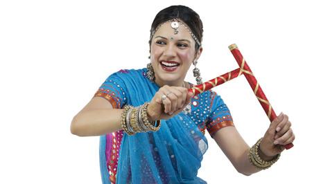 Gujarati woman with dandiya sticks
