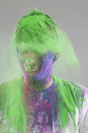Man covered with holi colours Imagens
