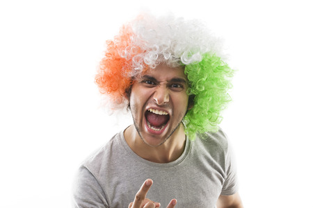 Young man with a wig shouting