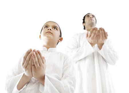 kurta: Muslim man and his son praying