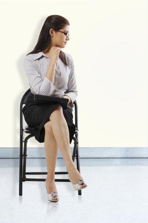 25 30: Secretary sitting on a chair