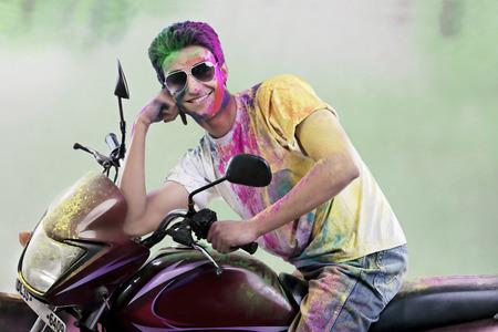 joyfulness: Man posing on a motorcycle