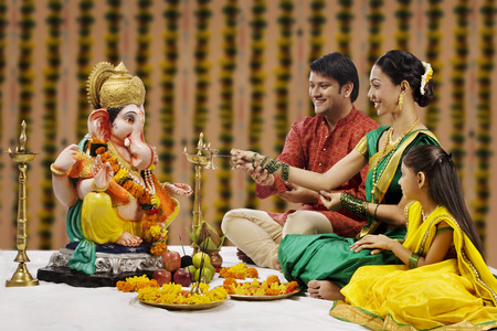 sacred source: Family performing a pooja