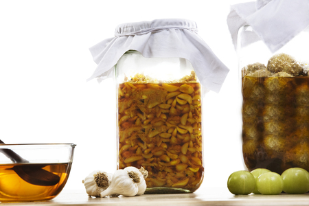 Jars filled with garlic and gooseberry pickle Stock Photo