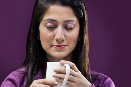 vapour: Woman smelling the coffee
