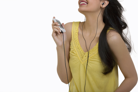 earbud: Girl listening to music on her mobile phone