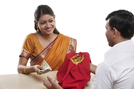 mortgaging: Woman mortgaging her jewelery Stock Photo