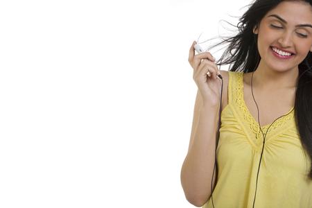 'eyes shut: Girl listening to music on her mobile phone