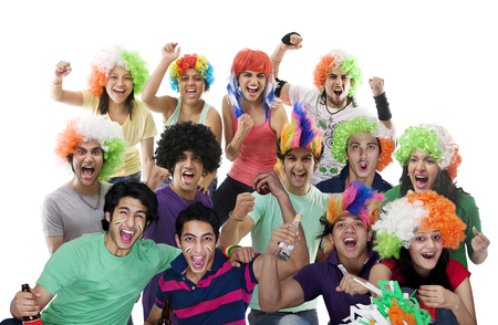 Portrait of youngsters with wigs cheering