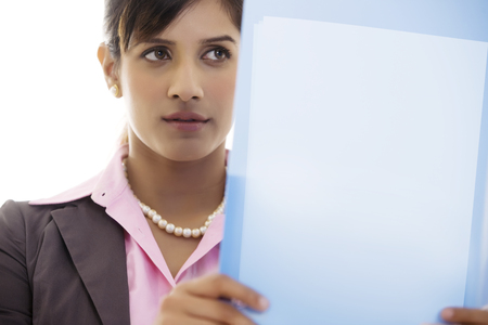 25 30: Businesswoman holding a file
