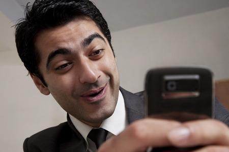 25 30: Businessman reading an sms