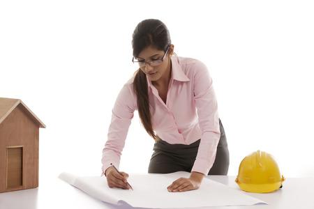 25 30: Female engineer making blueprints Stock Photo