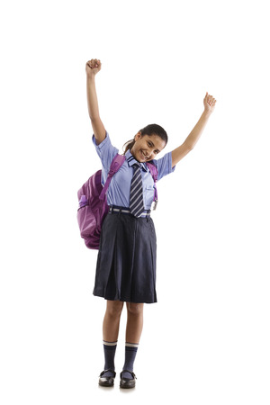 Portrait of a school girl cheering Stock Photo