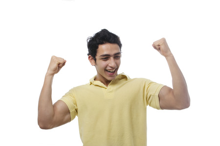 triumphant: Young boy feeling triumphant Stock Photo