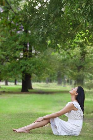 'eyes shut: Young woman enjoying nature
