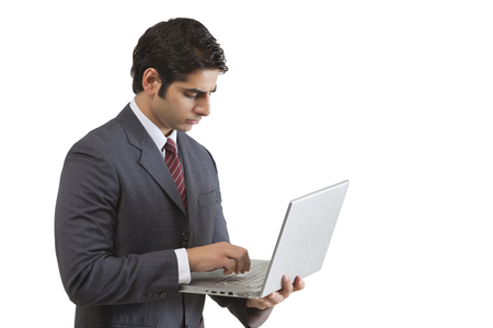 welldressed: Handsome young businessman working on laptop