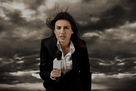 welldressed: News presenter in storm