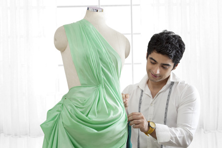 human likeness: Male tailor working on dressmakers form