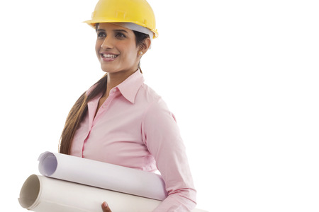 Female engineer with blueprints Stock Photo