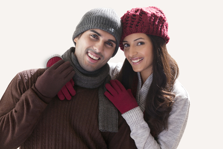 Portrait of smiling young couple over white background