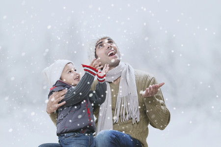 Father and son enjoying winter Stock Photo