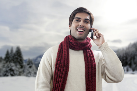 Portrait of young man having conversation on mobile phone