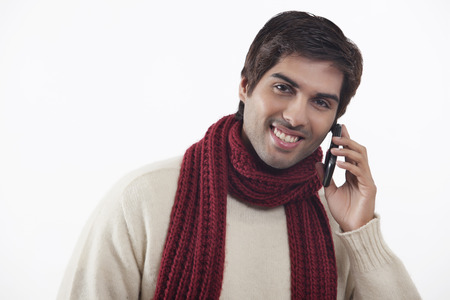 Close-up of young man talking on mobile phone Stock Photo