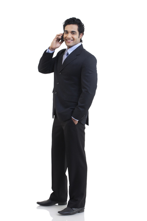 well dressed: Portrait of businessman talking on a mobile phone
