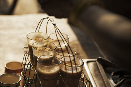 Close-up of chai in grid tray kept at a market stall counter