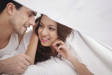 couple romancing in bed stock photo picture and royalty free image