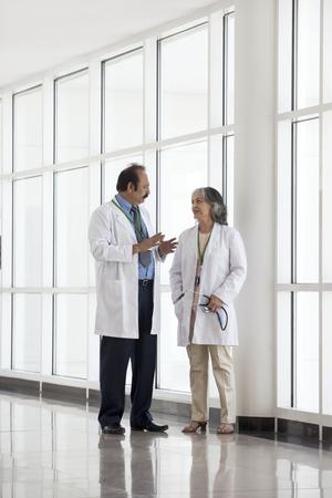 corridors: Two doctors talking in hospital corridor Stock Photo