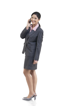 well dressed: Portrait of businesswoman talking on a mobile phone Stock Photo