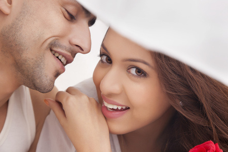 portrait of couple romancing in bed stock photo picture and royalty