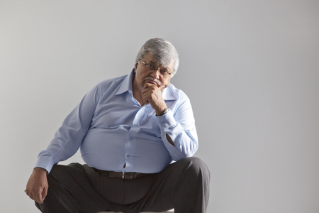 Portrait of an obese old man