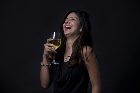 engage: Woman with a glass of wine laughing