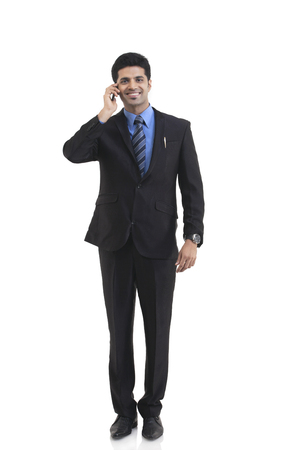 contact: Portrait of businessman talking on a mobile phone