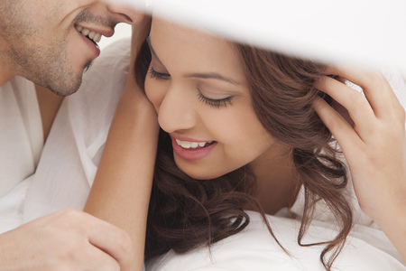 close up of couple romancing in bed stock photo picture and royalty