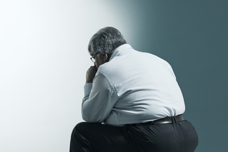 Obese old man sitting