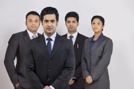Portrait of confident business people standing against gray background Stock Photo