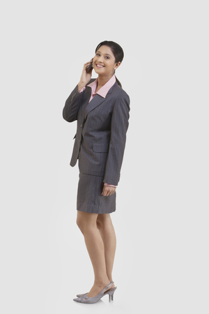 Portrait of businesswoman talking on a mobile phone Stock Photo