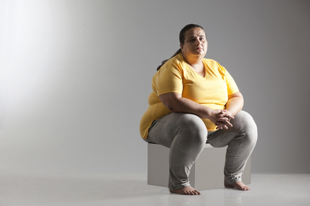 Portrait of an obese woman sitting