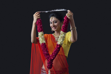 contact: Portrait of a smiling bride holding a garland Stock Photo