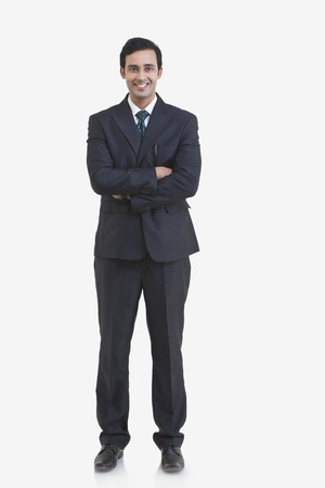 welldressed: Full length portrait of young businessman isolated over gray background