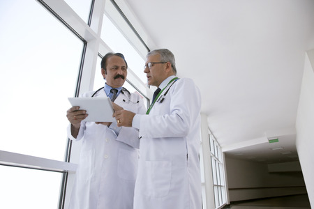 corridors: Two doctors with a digital tablet Stock Photo