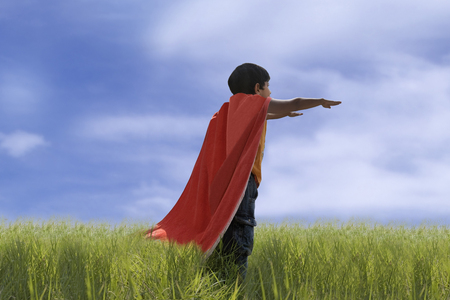 level playing field: Child posing as Superman