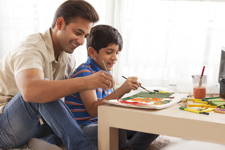 Father and son painting with water colors Stock Photo